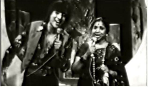 Watch the young dashing danny denzongpa and singing legend asha bhosle sing a popular