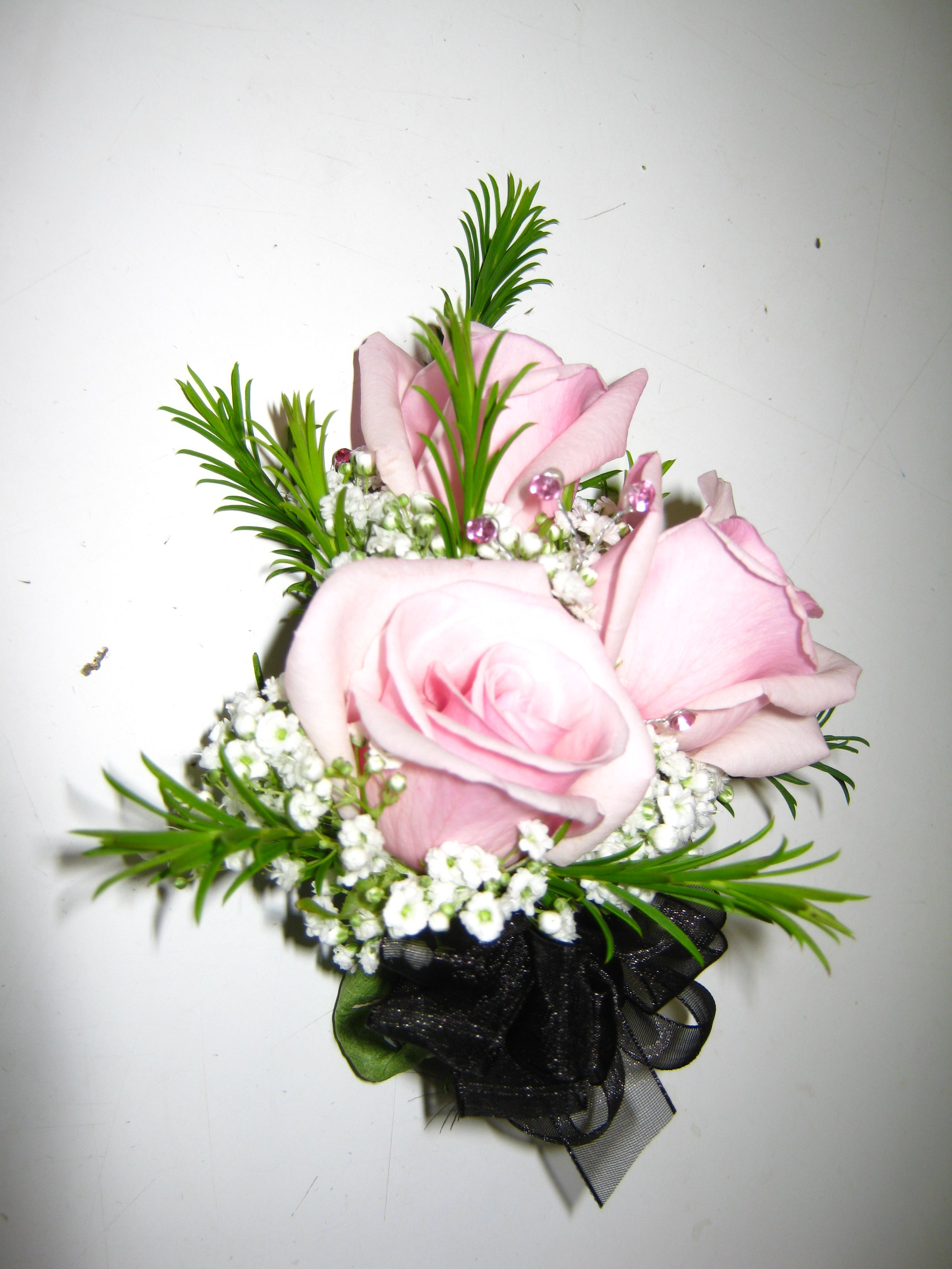 pink roses with baby's breath and honey bracelet corsage