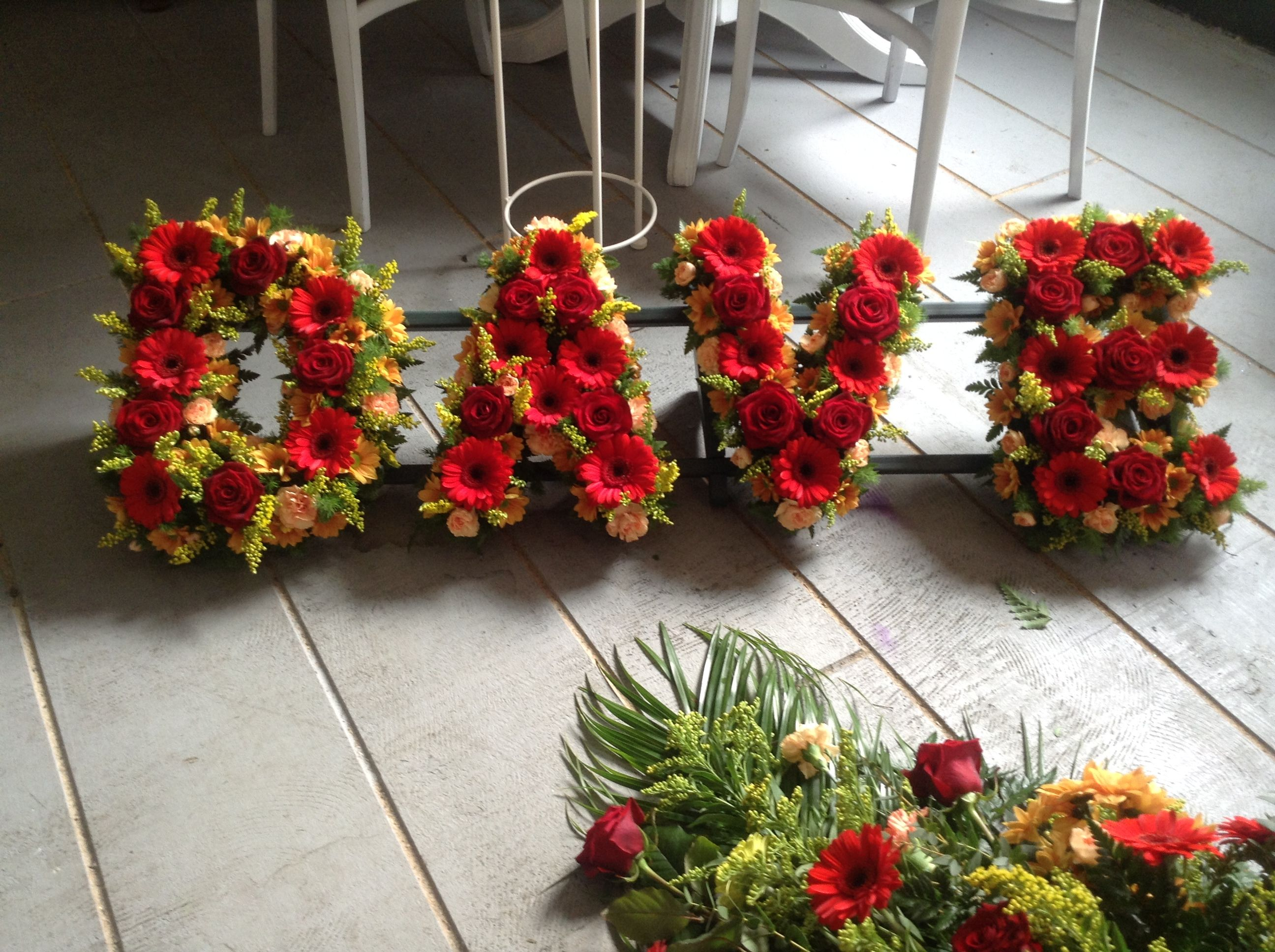 Funeral flowers dave funeral flower letter tribute red gerberas funeral flowers dave funeral flower letter tribute red gerberas red and gold letter izmirmasajfo Choice Image