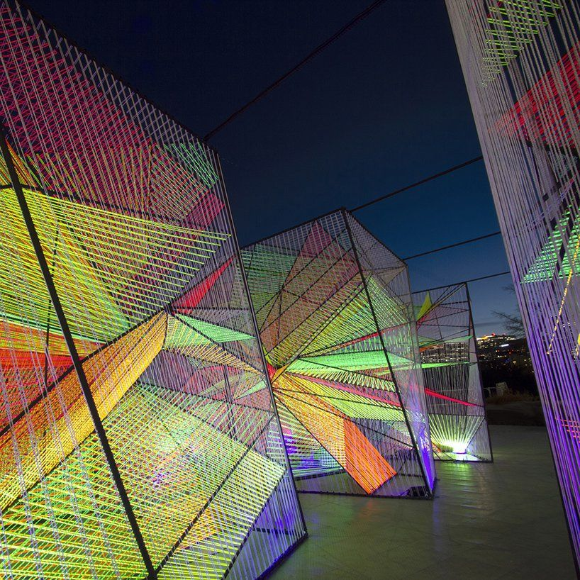 hou de sousa's iridescent prismatic installation in georgetown frames a myriad of perspectives