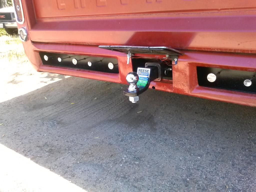 Hidden tow hitch behind the plate