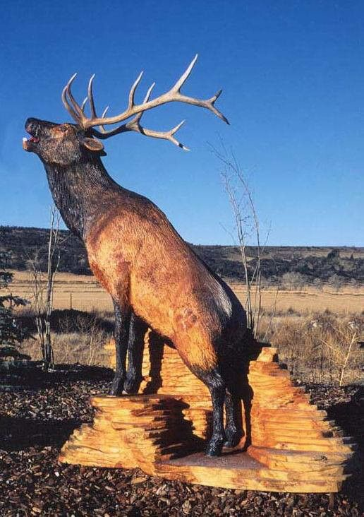 Awesome chainsaw art work if an elk hunting