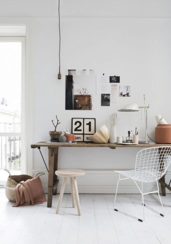 Scandinavian interior design meets rustic elements. What a beautiful working  area. This bright and