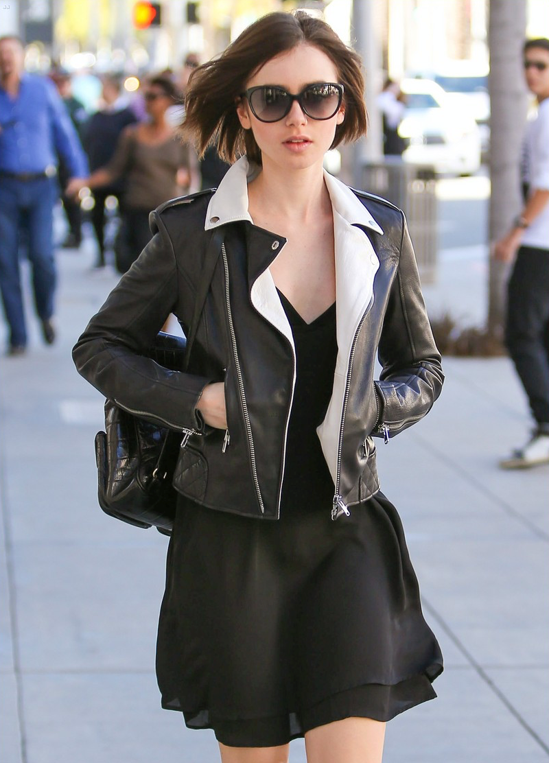 5f2f0666699e Actress Lily Collins, getting the looks in Beverly Hills wearing IVI  Daggerwing Sunglasses.