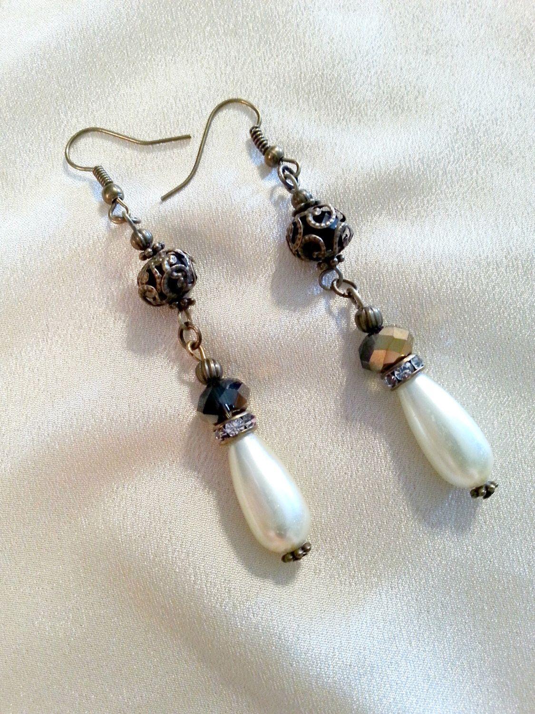Pearl Dangle Earrings ~ Pearl and Rhinestone Dangle Earrings ~ Antique Bronze Rhinestone Pearl Drop Earrings ~ Bridal Jewelry ~ Prom Jewelry by MissGawdysJewelry on Etsy https://www.etsy.com/listing/269876095/pearl-dangle-earrings-pearl-and