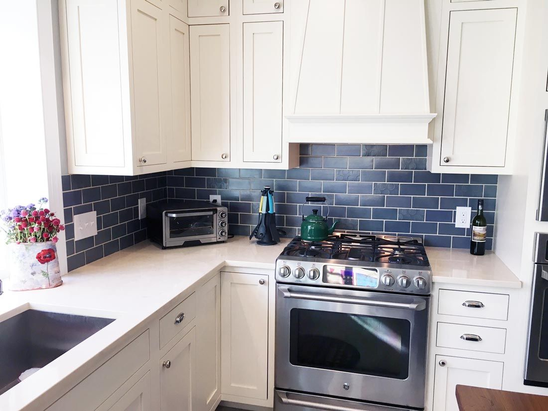 Navy Subway backsplash, white cabinets, white counter, butcher block ...