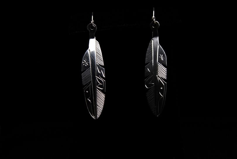 Eagle Feather earrings by Tim Taylor from the Tseshat Nation of the Nuu-chah-nulth nation. Northwest coast fine art at Ahtsik Native Art Gallery.