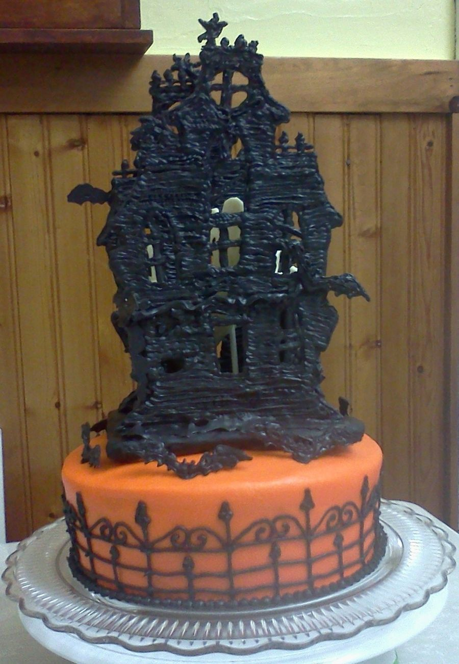 Haunted House 2011 Haunted House 2011 I got this idea from Wilton Yearbook, but I decided to give my house 4 walls, a 3D gate, & added white choc ghosts... #featured-cakes #halloween #haunted-house #cakecentral