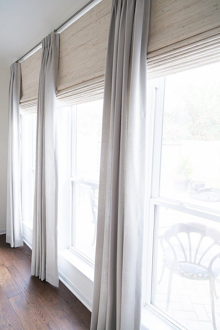 Drapery Treatment - gray linen and grass roman shades with gilded rings and  crystal finial