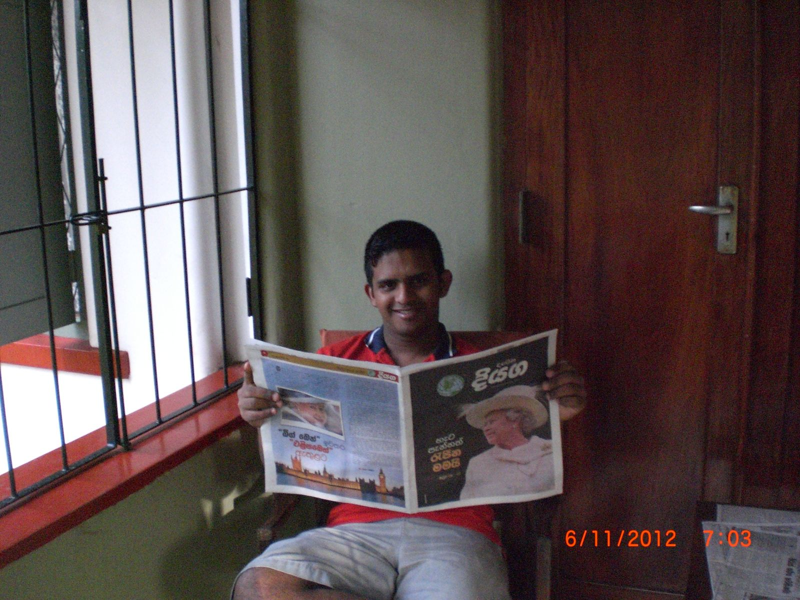 Pavara reading a traditional newspaper in Sri Lanka    Picture by Pavara
