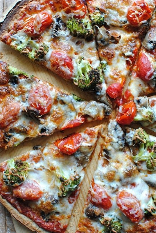 Thin crust pizza with tomatoes, mushrooms, and broccoli... everything I love! @Bevvvvverly Weidner