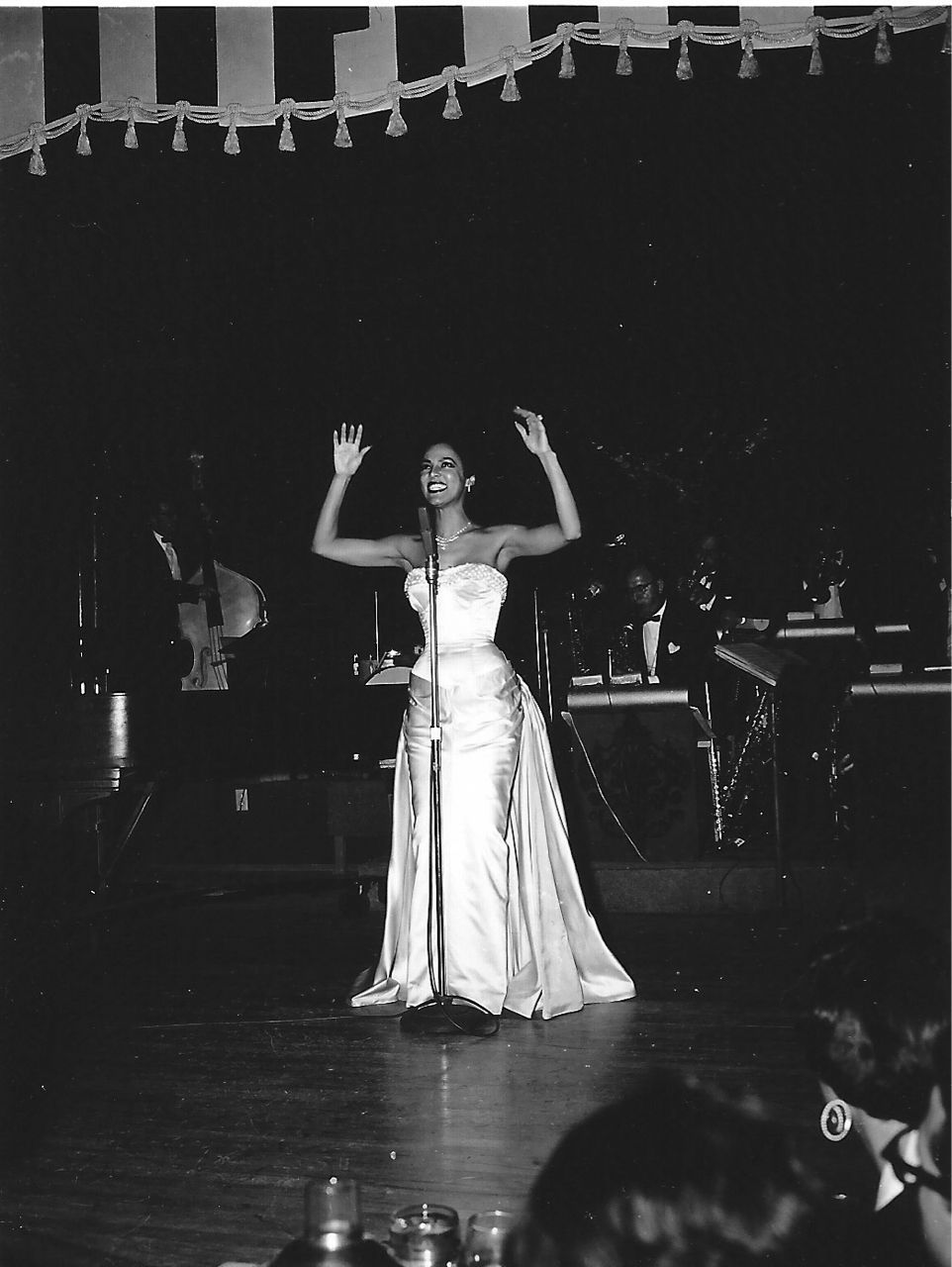 1954 photo of Dorothy Dandridge performing at the Last Frontier Hotel in Las Vegas. On her closing night, a new one night attendance record of 1,263 was set. This was the same hotel that in 1953 drained the pool after Dottie deliberately dipped her toe in it (because blacks were not welcome in the pool area). Remember that scene in Introducing Dorothy Dandridge??
