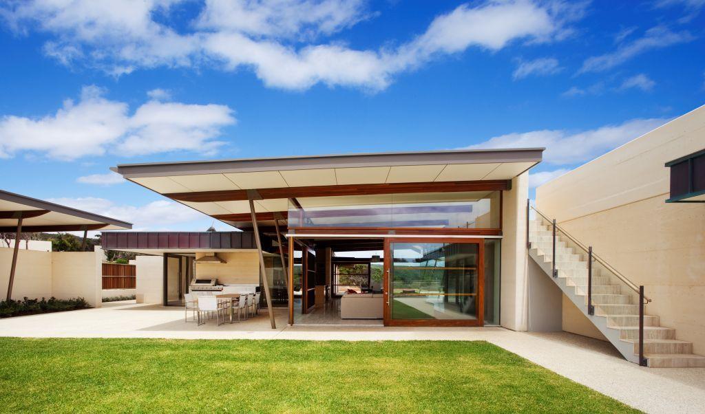 Stunning view from a modern minimalist house green grass backyard