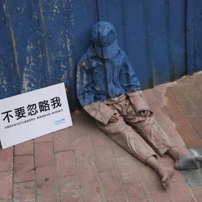 Don't Ignore Me - Transparent homeless child  StreetArt Campaign China