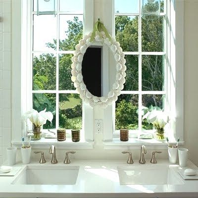 Bathroom Mirrors Over Windows shell mirror focal point in the bathroom, hanging in front of