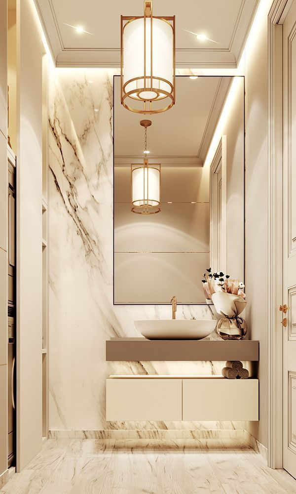 Luxurious bathroom with marble and gold details wall