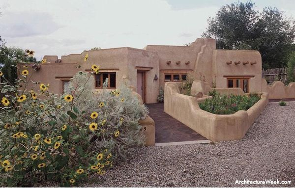 Taos adobe style homes this new pueblo style house in for Adobe construction pueblo co