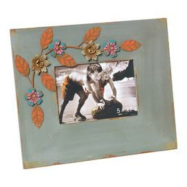 """Gray picture frame with a warmly weathered finish and floral detail.      Product: Photo frameConstruction Material: Wood, metal and glassColor: GrayFeatures: Holds one 5"""" x 7"""" photoDimensions: 11"""" H x 13"""" W"""