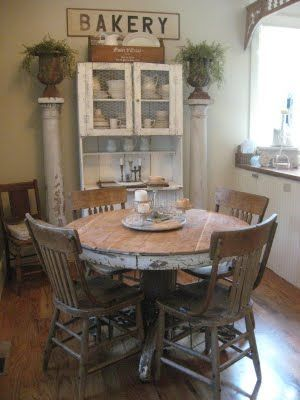 Shabby Farmhouse Dining Distressed Chipped Round Oak Table Wood House Posts Old Cupboard Bakery Sign