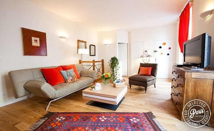 This one bedroom duplex is characterized by bright colors, modern