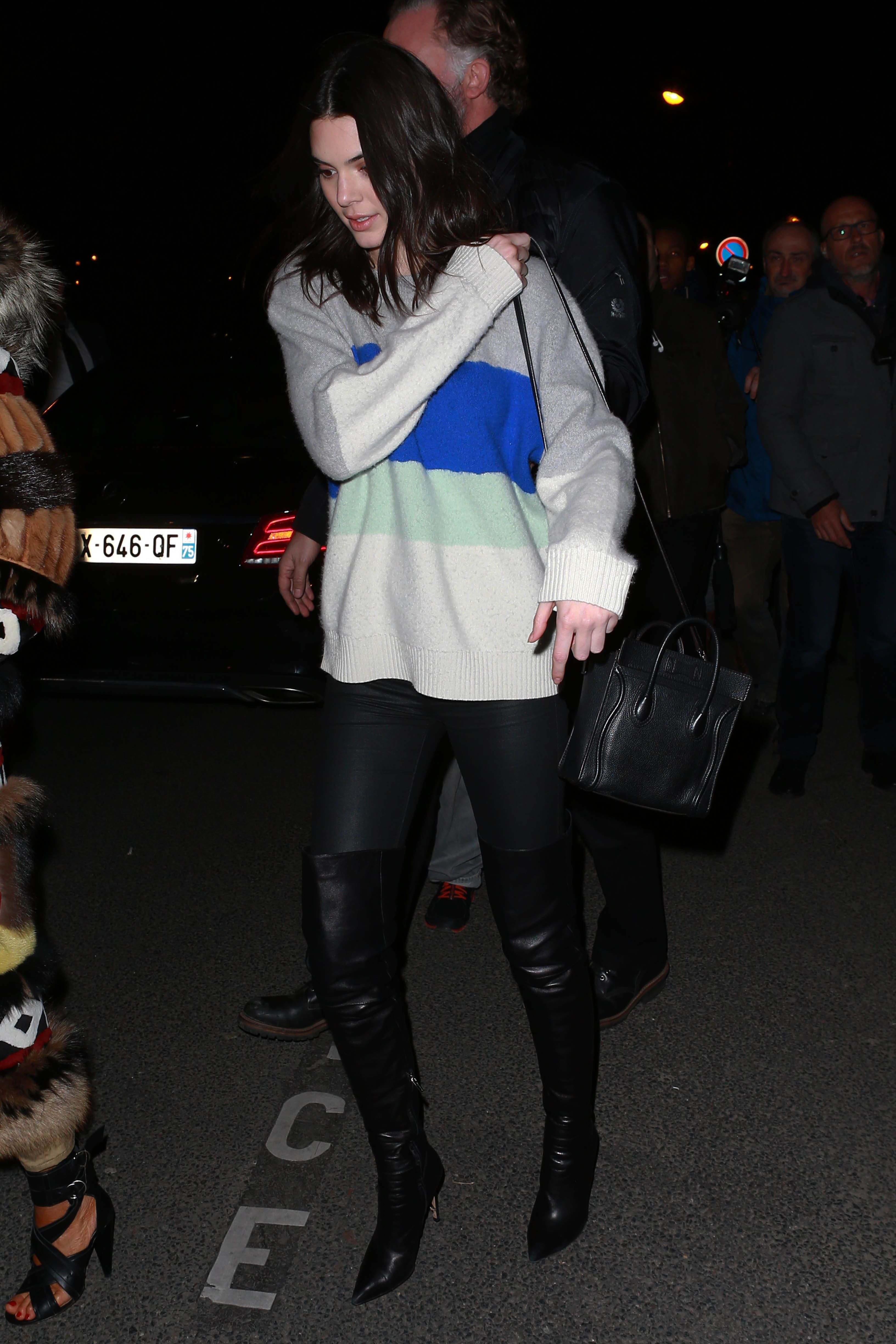Kendall looks soooo comfy in this thick, striped sweater and tall black  boots. , Seventeen.com