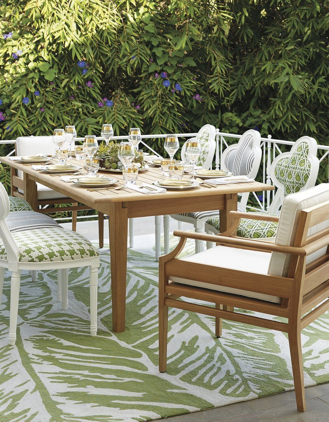 Inspired by classic garden style the whimsical quatrefoil outdoor dining chair features intricate handcarved details that were captured by the molds used