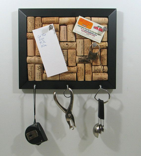 wine cork key rack..Have the board made, would be awesome to put key hooks on the bottom of it!