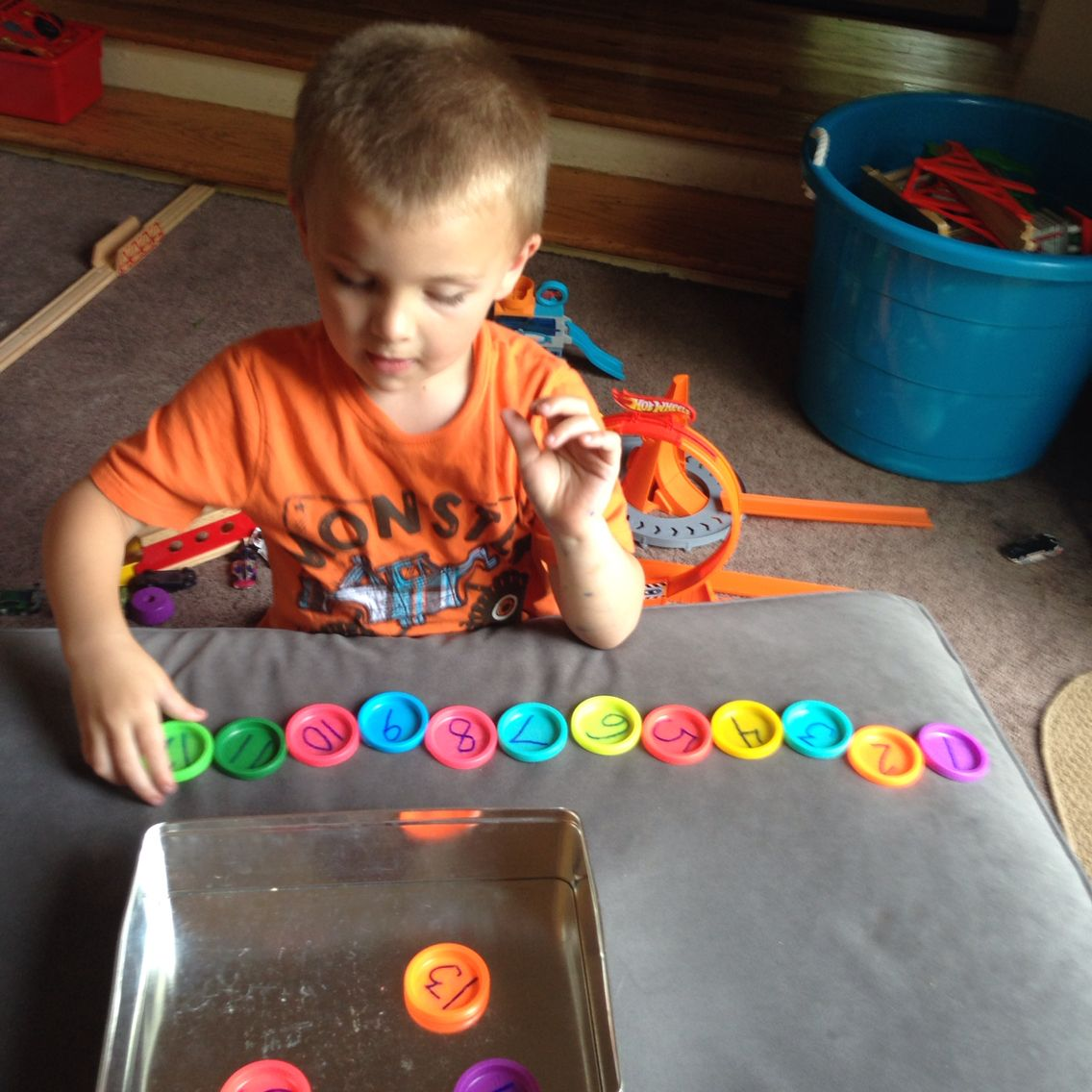 Ordering Numbers With Numbered Play Dough Lids
