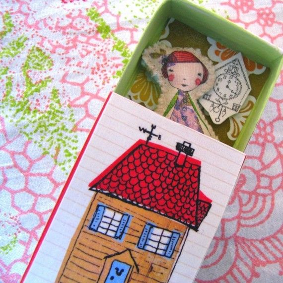 Mini camille doll in her little house (via lovelysweetwilliam on etsy) She lives in a matchbox doll house with her budgie friend or her cuckoo clock and she dreams about all her adventures. She dreams of talking to elephants, riding with swans in the moonlight and flying with angels. She loves to hear about other dreams too. She is hand stitched on to felt, slightly stuffed, and sits neatly in her house.