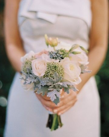The ladies at this Charleston, South Carolina, wedding carried petite posies of garden roses, trachelium, lisianthus, and dusty miller.