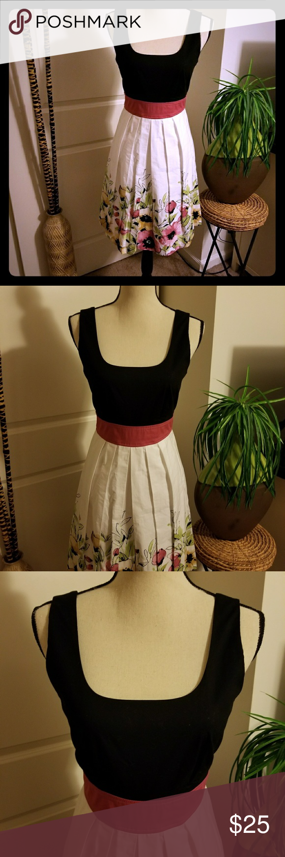 Dress Black top, mauve center and floral bottom.Tie back dress worn a few times, total length 37 inches. Maurices Dresses Midi