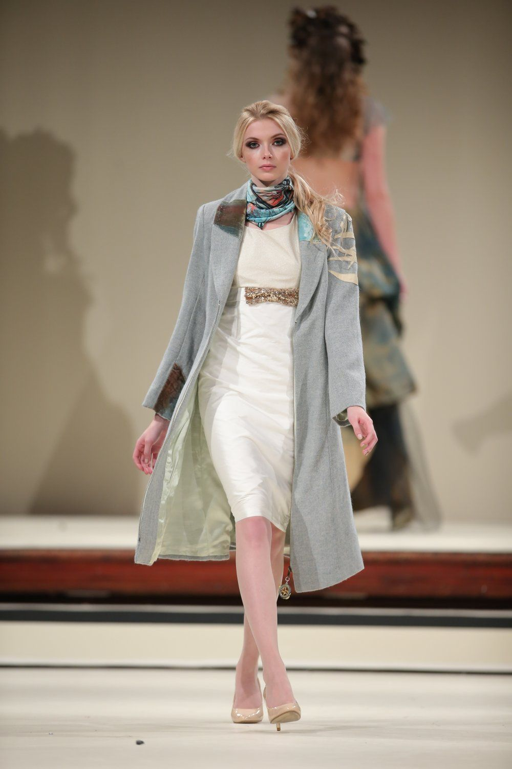 Blue wool dress coat with decorative appliqué by Goddess and Swift designed in United Kingdom