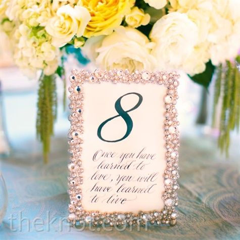 Glam Silver Frames Drew Attention To The Table Numbers Which Each Featured A Quote Related