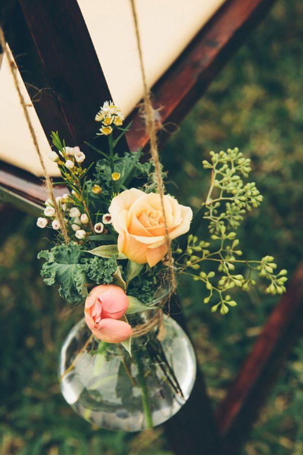 hanging aisle decor, photo by Parker Young http://ruffledblog.com/backyard-tampa-wedding #weddingideas #ceremony #flowers