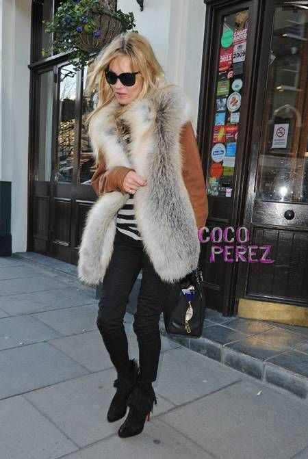 Kate Moss in fur and Christian Louboutin fringe boots