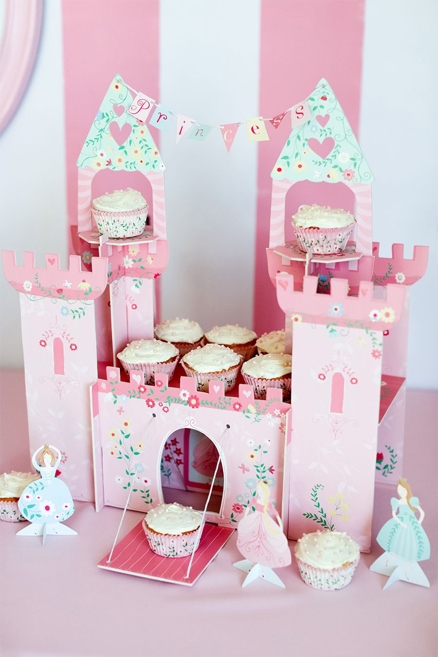 Serve cupcakes on a castle stand! Not only is it festive, but it ...
