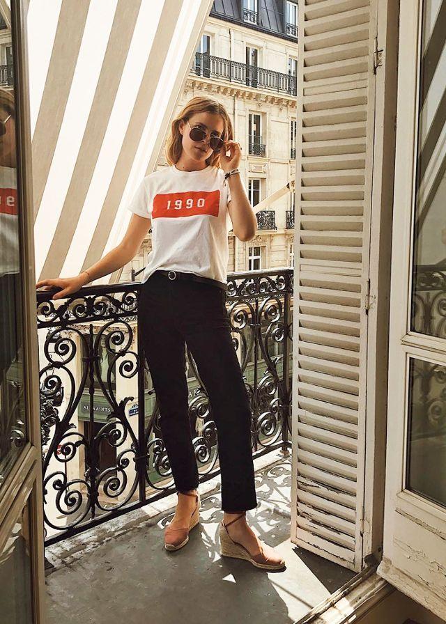 Inès Mélia in dark jeans and white t-shirt.
