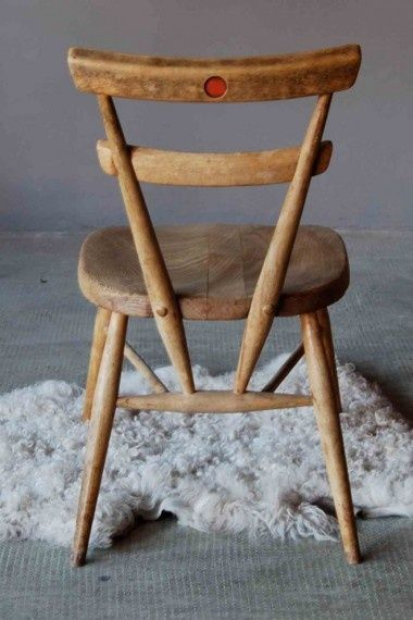 Ercol school stacking chair. The coloured dot on the back ...
