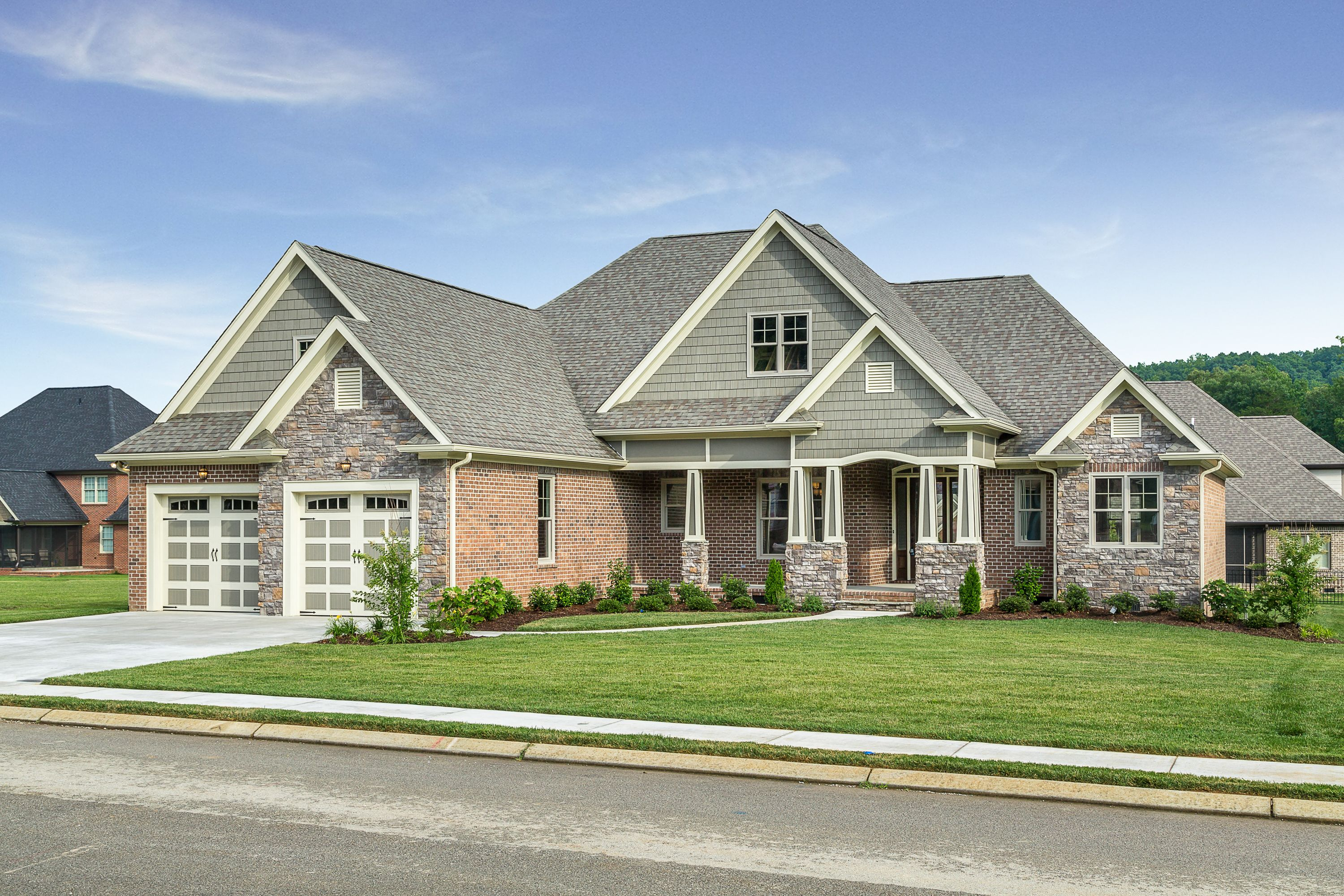 Brick stone and shake the wilkerson plan 1296 built by for Stone house floor plans