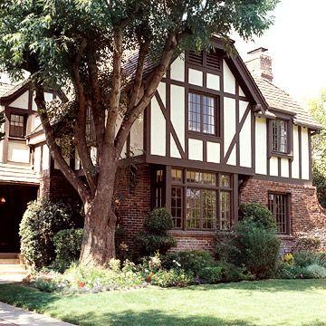 Stucco Siding A Visual Guide To Siding Options Stucco Siding Tudor Style Homes Tudor House Exterior