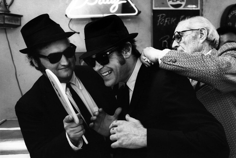 JOHN BELUSHI AND DAN AYKROYD John Belushi and Dan Aykroyd have a laugh  during the production of The Blues Brothers 375e517f5d54