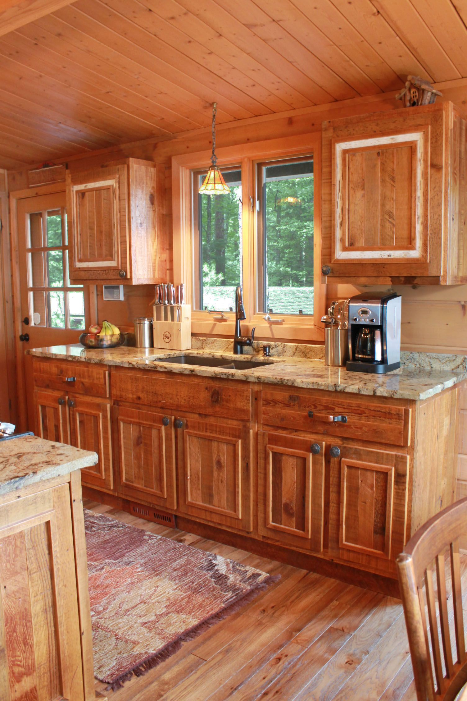 This charming, rustic, cabin's kitchen is made from 100 ...