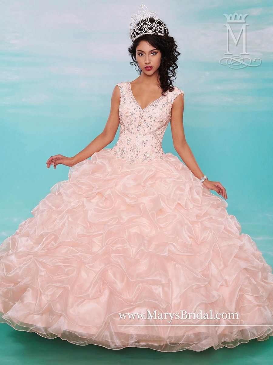 Look irresistibly pretty in the opulent organza Marys Bridal Beloving 4602 quinceanera dress. The beautiful bodice features a V-neckline and is embellished with exquisite embroidery and adorable beading. Slight cap sleeves lead to the semi-open lace-up back. The ball gown skirt is a shimmering extravaganza of frothy ruffles, complementing the ruffled puff sleeves on the matching sheer bolero.