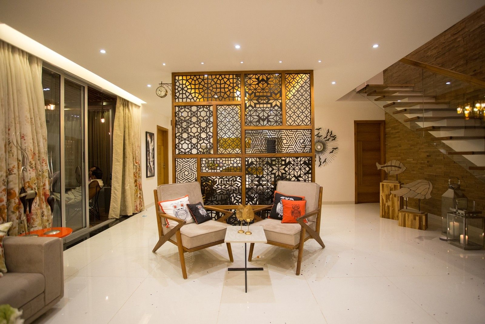 Wide Living Room Furnished With Wooden Chairs With Spongy Gadi
