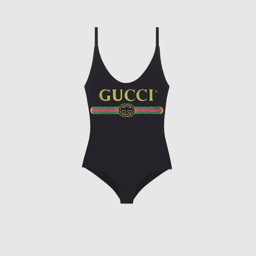 020f717f0cba6 Shop the Sparkling swimsuit with Gucci logo by Gucci. Inspired by prints  from the '80s, the reclaimed Gucci vintage logo enhances a sparkling  swimsuit in ...