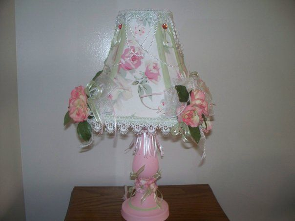 Princess lamp made with an extra valance that came with the comforter set. Just used fabric glue for the actual shade and hot glue for the decorations. It all started out white.