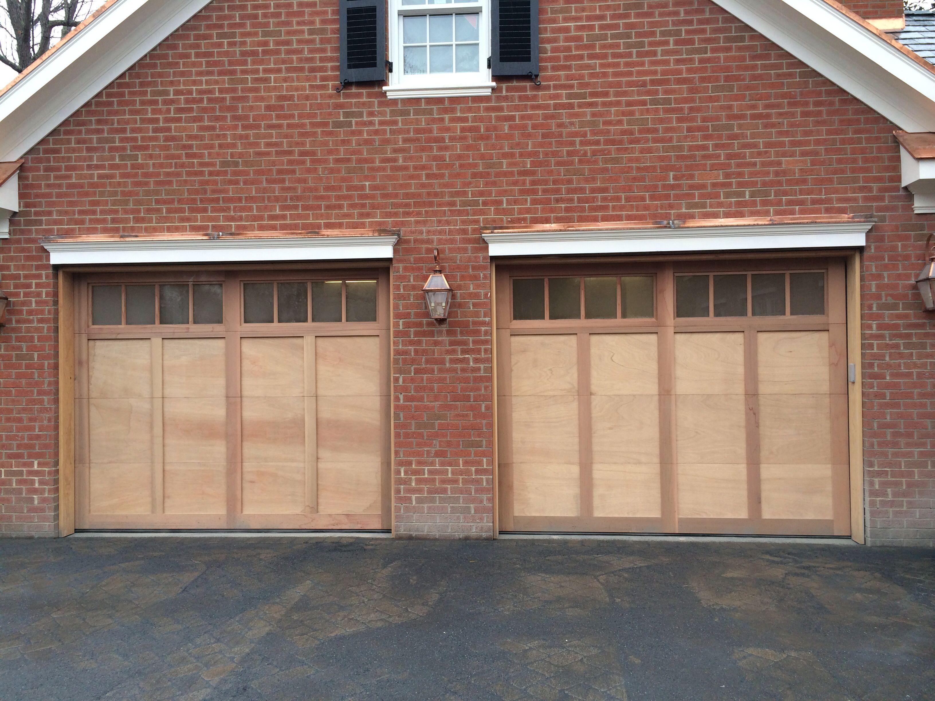 Mahogany flush garage doors with clear cedar trim boards for Garage doors charlotte nc