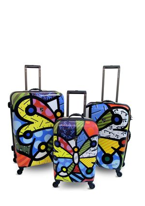 779140dd2 Bright, colorful and artsy luggage makes traveling fun and makes it easy to  spot your luggage at the baggage claim. Saw these in a gallery in Miami and  ...