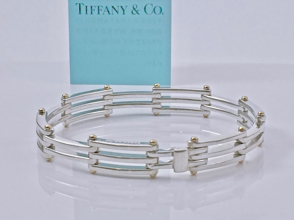 e6c831c84 A uthentic Tiffany & Co. 925 Sterling Silver with 18k Solid Yellow Gold  Gate Link Bracelet. Excellent condition with unnoticeable normal wear.