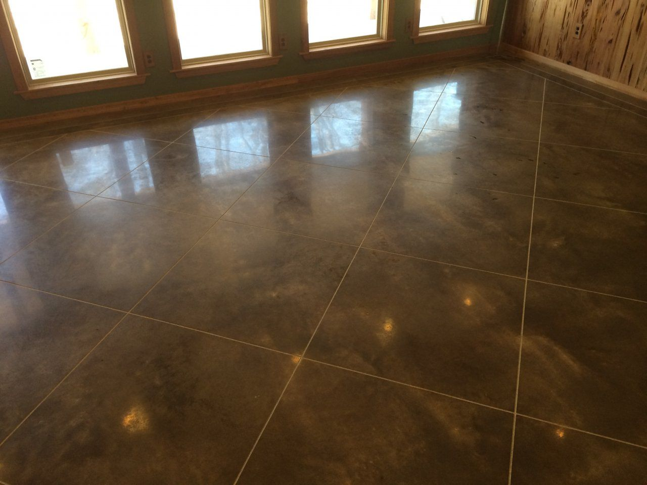 Scored, Stained and Polished Interior Concrete Flooring in DeWitt, Arkansas.